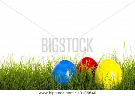 red blue and yellow easter egg in grass