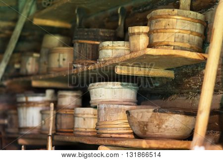 Storage racks with old wooden bowls. Closeup view