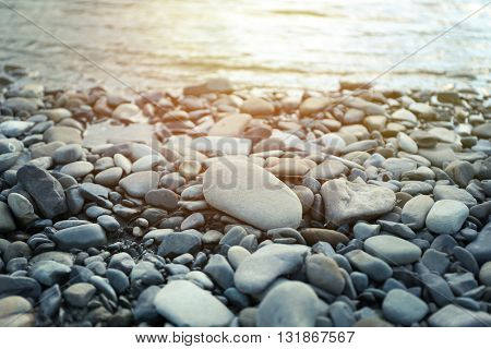 Nature background with pebble on sunset