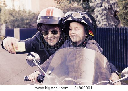 Motorbikers Father And Son Take A Selfie On The Road