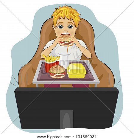 obese fat boy sits in a chair eating hamburger and watching tv