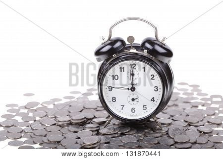 Old vintage clock on a money coins. Polish zloty currency.