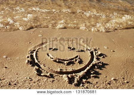 Funny Smile Face Drawn On Wet Sand Near Sea