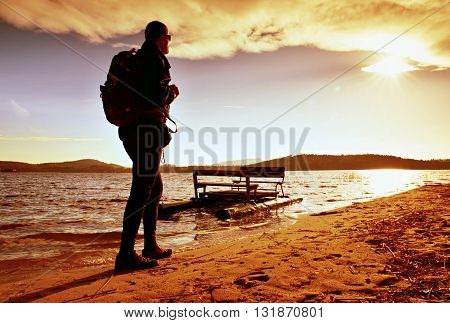 Walk Along Sea. Man With Backpack Walk On Beach At Rusty  Pedal Boat. Autumn At Sea.