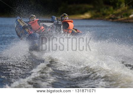 ST. PETERSBURG, RUSSIA - AUGUST 15, 2015: Unidentified riders compete in the River marathon Oreshek Fortress race. This international motorboat competitions is held since 2003