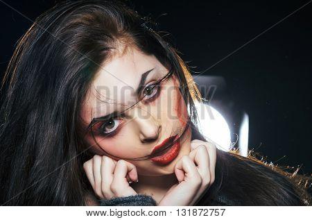 Fashion portrait of emotional woman in the dark
