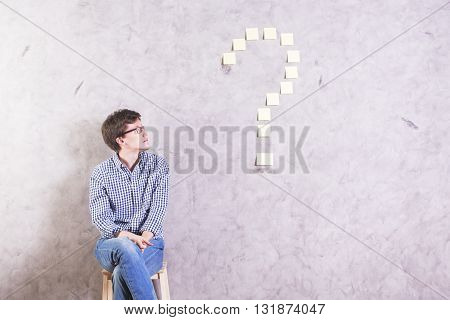 Guy Looking At Question Mark