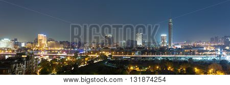 Panoramic view of central Cairo skyline at night.