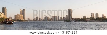 Cairo Egypt - May 26 2016: Panoramic view of central Cairo at dusk the Nile river and the Island of Zamalek.