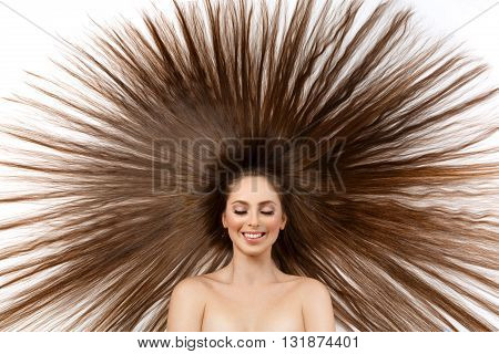Beautiful happy young woman with long silky brown hair