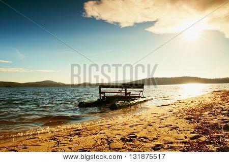 Abandoned Old Rusty Paddle Boat Stuck On Sand Of Beach. Wavy Level, Islad On Horizon. Autumn Weather