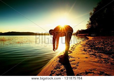 Silhouette Of Sport Active Adult Man Running And Exercising On The Beach. Calm Water, Island And Sun