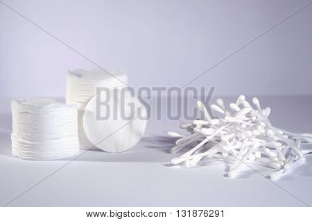 hygiene cotton pads and cotton swabs on light grey background
