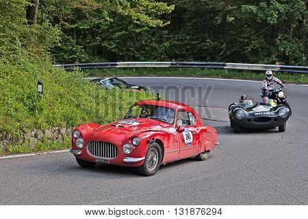 PASSO DELLA FUTA (FI) ITALY - MAY 21: driver and co-driver on a vintage sportscar Fiat 8V Berlinetta (1952) in classic car race Mille Miglia on May 21, 2016 in Passo della Futa (FI) Italy
