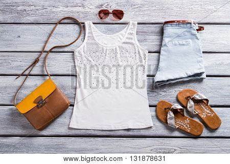 White tank top and sunglasses. Brown flip flops and purse. Buy some clothes for spring.