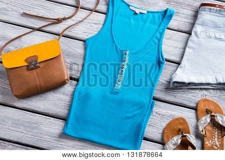 Blue tank top and purse. Bicolor bag and flip flops. Lady's colorful top for summer.