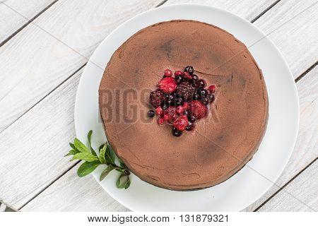 Chocolate cake with Ganache and berries (strawberries blueberries blackberries and rapsberry) fruit