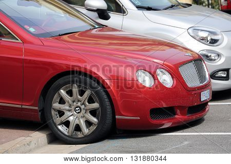 Monte-Carlo Monaco - May 28 2016: British Luxury Car Bentley Continental GTC Badly Parked on the Sidewalk in Monaco