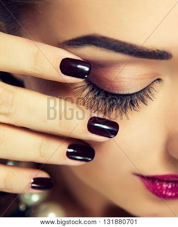 Luxury fashion style, manicure nail , cosmetics and makeup .  vinous nails . Trendy  make up and eyelashes