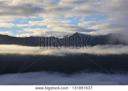 Fogy morning in the Southern Alps. View from Mt Robert New Zealand.