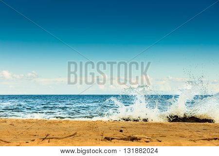 Seascape. Sea waves on the shore of the sandy beach. Summer vacation in the resort.