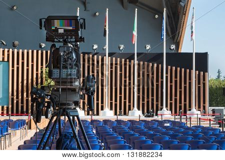 Empty Conference Room with Television Camera Ready for Audience