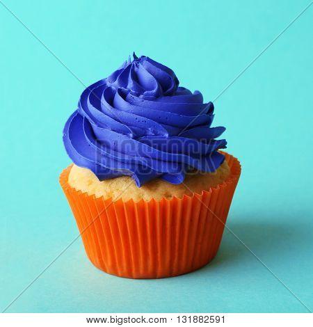Birthday cupcake on turquoise background