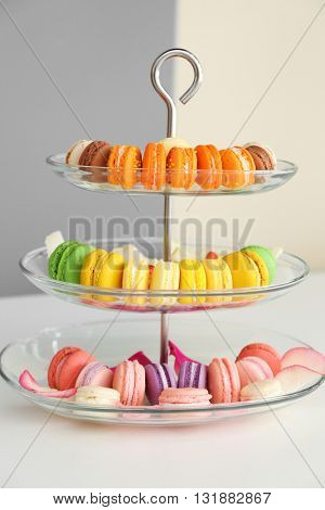 Fresh macaroons on a cake stand
