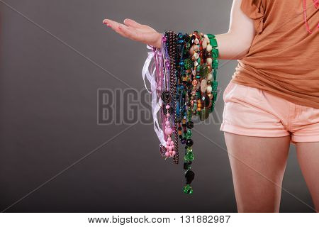 Closeup Of Woman With Jewelry Necklaces Beads.