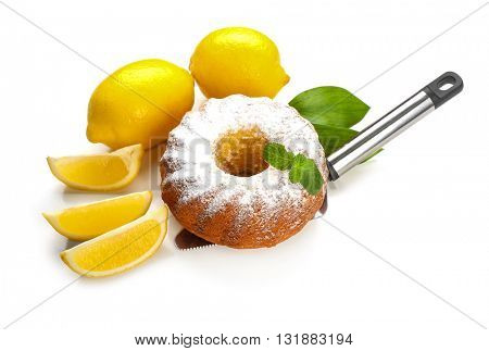 Delicious citrus cake with lemons on white background