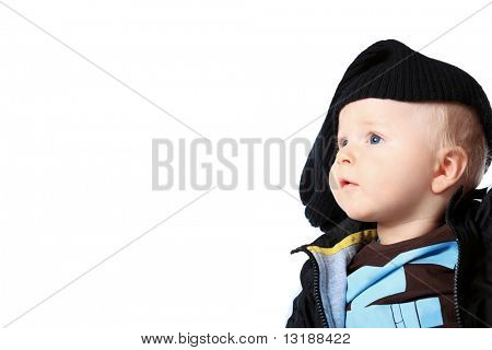 Beautiful little boy. Shot in a studio. Isolated over white background.