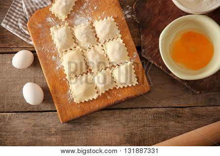 Uncooked ravioli on cutting board