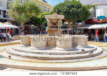 Heraklion, Greece - April 24, 2016: A beautiful stone fountain with sculptures in the capital of Crete. The area around the fountain is a favorite holiday destination for residents and tourists.
