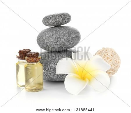 Spa treatment with stones and oil, isolated on white