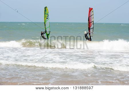PHRACHUAP KHIRI KHUN,THAILAND-DECEMBER 20,2013 : Unidentified Kite Surfers during a practice of Kite surf  in the sea near Phranburi District.Phrachuap Khiri Khun Province in Middle of Thailand.