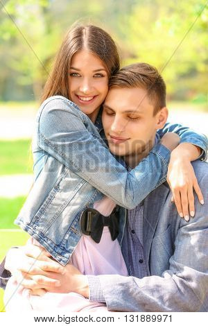 Young loving couple in spring park