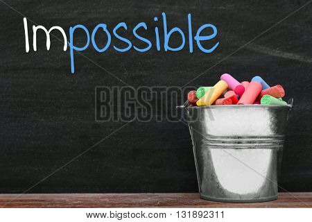 Word impossible transformed into possible on blackboard