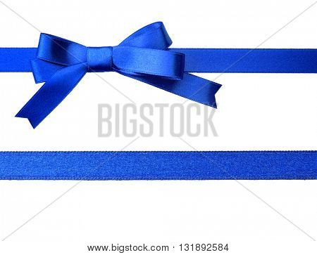 Blue horizontal ribbons and bow, isolated on white