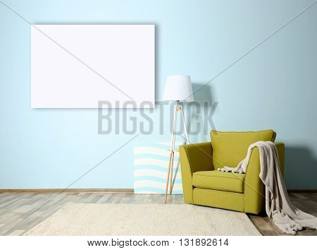 Room interior with green armchair and empty picture frame on blue wall background
