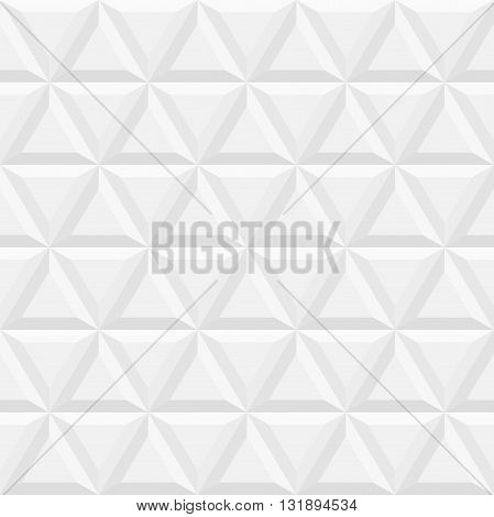 Geometric pattern with volume light gray triangles. Seamless abstract background