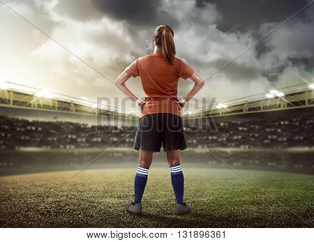 Female Football Player Standing On The Field