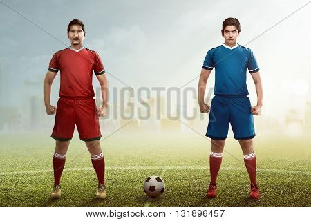 Two Football Player Posing On The Kickoff