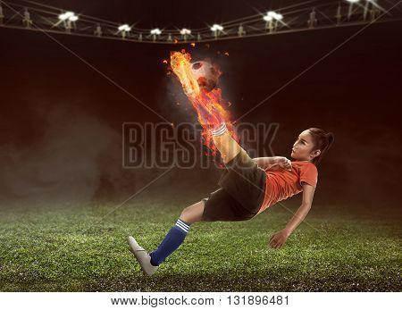 Football Player Kick Fire Ball On The Stadium