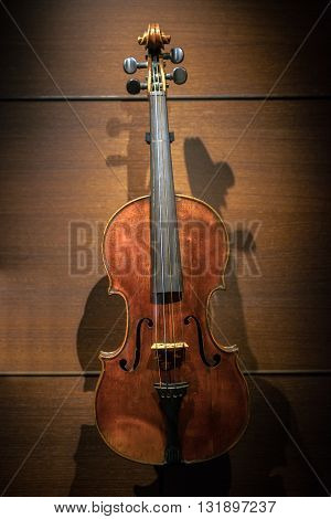 Closeup photo of an aged musical instrument violin