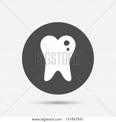 Caries tooth icon. Tooth filling sign. Dental care symbol. Gray circle button with icon. Vector
