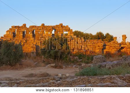 Old ruins in Side Turkey at sunset - archeology background