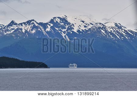JUNEAU, ALASKA, USA.  MAY 18, 2016.  A ship from Princess Cruises approaches Juneau, Alaska.