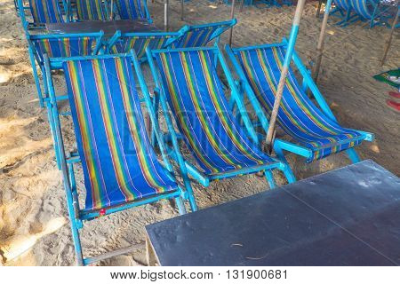 Blue beach chairs at Cha-Am beach Thailand