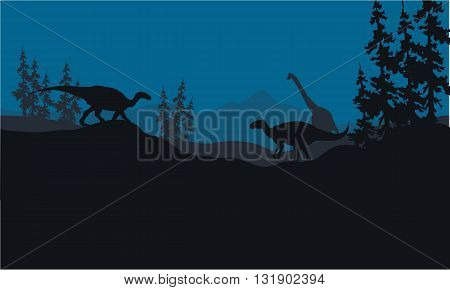 Silhouette of Brachiosaurus and Iguanodon in hills at night