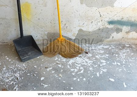 dustpan and broom for cleaning in home